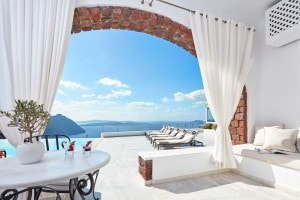 San Antonio Santorini Hotel Classic Double Room opens up to a private sea view veranda with sun beds