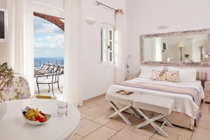 The elegantly designed bedroom of the Classic Double Sea View Room at San Antonio Hotel in Santorini
