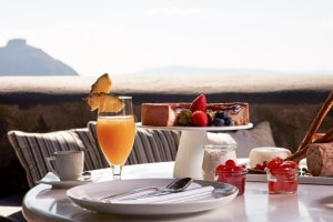 Room service delivery of OJ, cake & fruit on the private sea view veranda of the Classic Double Room