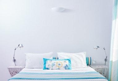 Bed in San Antonio caldera view Hotel Junior Suite sea view accommodation in Imerovigli, Santorini