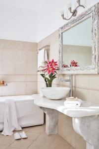 Junior Suite Sea View luxury bathroom with bathtub at San Antonio Hotel in Imerovigli, Santorini