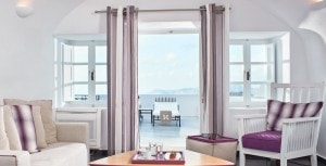 Living room & balcony in San Antonio Santorini Hotel Master Suite sea view luxury accommodation