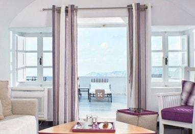 Living room & balcony in San Antonio Santorini Hotel Master Suite sea view luxury accommodation