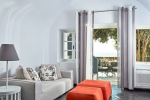 Master Suite sofa & stools by private sea view balcony terrace at San Antonio Santorini luxury Hotel