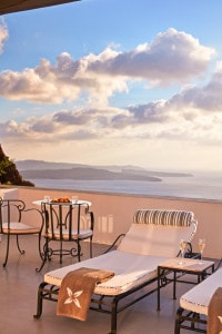 Sunbeds on private balcony terrace with Santorini Caldera sea view in San Antonio Hotel Master Suite