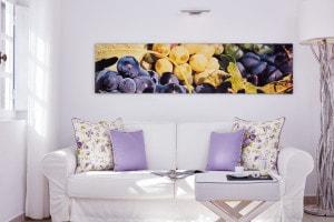 Sofa in living room area of the Suite Sea View at San Antonio luxury Hotel in Imerovigli, Santorini