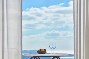 Water glasses & fruit on table on Suite Sea View private balcony veranda in Imerovigli, Santorini