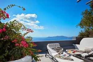 Sunbeds & flowers on a sea view balcony at San Antonio luxury Hotel in Imerovigli, Santorini