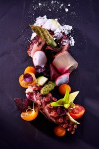 Gourmet seafood octopus dish served at San Antonio Hotel Cliffside Dinner Restaurant in Santorini
