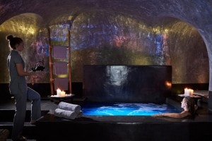 Spa service while relaxing in the Jacuzzi at San Antonio Hotel volcanic spa suite in Santorini