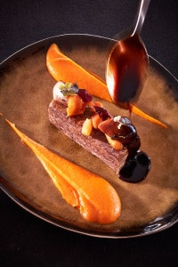Elegant nouvelle cuisine style Meat dish at Cliffside romantic dinner restaurant in Santorini