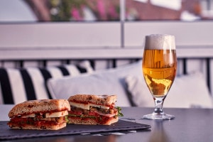 Enjoy a glass of beer & a sandwich with a great sea view at Cliffside Dinner Restaurant in Santorini