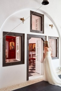 San Antonio Luxury Hotel has its own wedding chapel carved into the Santorini caldera cliff