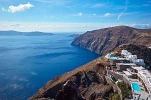 High level photo of the San Antonio Hotel buildings, built on the side of Santorini cliff caldera