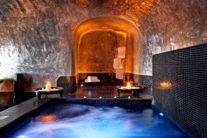 The luxury Jacuzzi in the volcanic cave spa suite at San Antonio Hotel in Imerovigli, Santorini