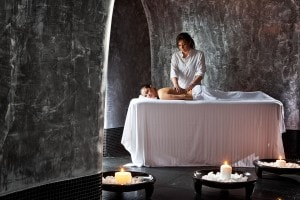 Masseuse provides treatments to a lady in the San Antonio luxury Hotel Spa in Imerovigli, Santorini