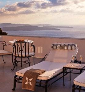Sunbeds & drinks on the veranda by the pool facilities at San Antonio luxury Hotel in Santorini