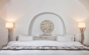Bedroom in the Imerovigli luxury rooms & suites at San Antonio Santorini 5 star sea view hotel