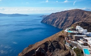 Aerial view of San Antonio hotel in Imerovigli, which offers a view of the sea & Santorini caldera