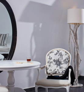 Chair, lamp, mirror & table in a luxury suite at San Antonio boutique Hotel in Imerovigli, Santorini