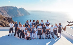 Staff pose for a photo at San Antonio Santorini boutique caldera Hotel in the village of Imerovigli