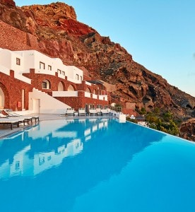 The infinity pool & the exterior of San Antonio Luxury Hotel on the cliffside of Santorini caldera
