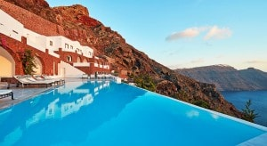 The luxury infinity pool is located beside the San Antonio Hotel, on the edge of Santorini caldera