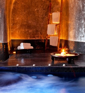 Spa Jacuzzi, towels & candle in the San Antonio luxury Hotel volcanic spa suite in Santorini
