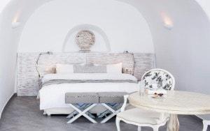 Bedroom of the Suite Sea View luxury accommodation at San Antonio Santorini Hotel in Imerovigli.